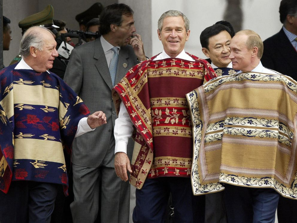 PHOTO: President George W. Bush wears a traditional Chilean poncho with Chilean President Ricardo Lagos, left, and Russian President Vladimir Putin at the La Moneda Presidential Palace during the APEC Summit Nov. 21, 2004 in Santiago, Chile.