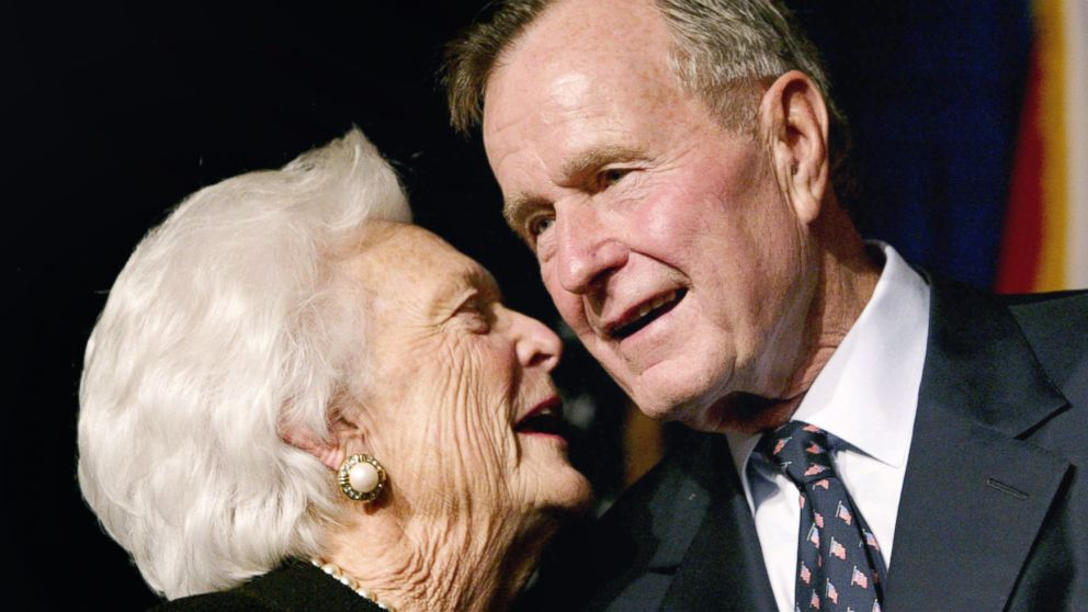 Former U.S. President George Bush speaks with his wife Barbara as their son, Florida Republican gubernatorial candidate, incumbent Gov. Jeb Bush, celebrates victory at his election night party in Miami, Nov. 5, 2002.