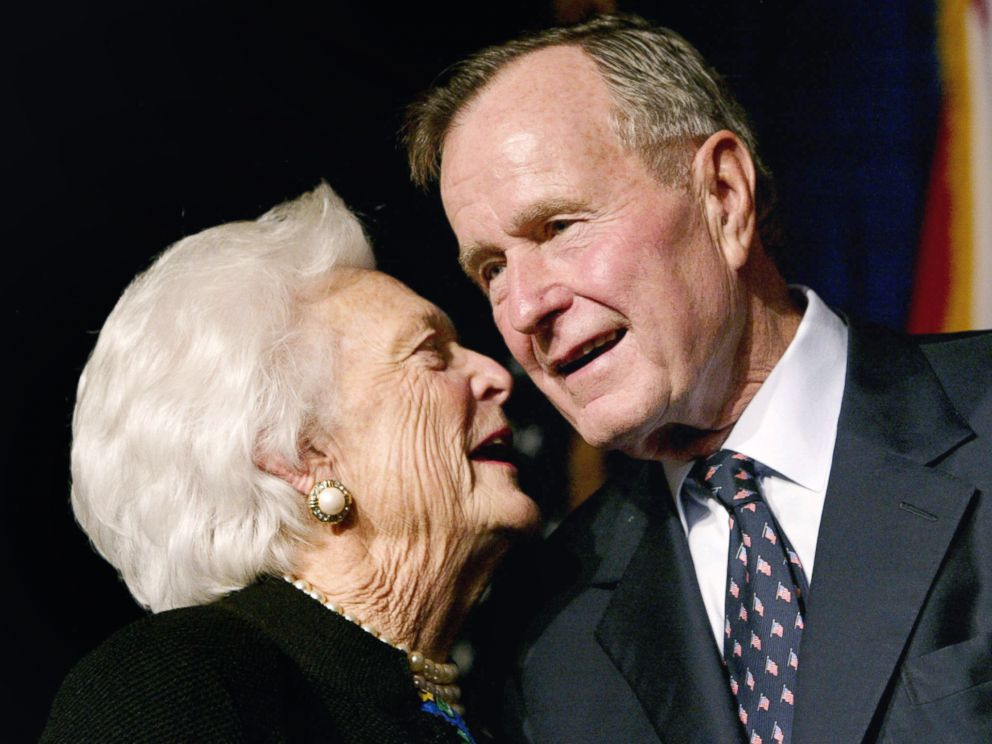 PHOTO: Former U.S. President George Bush speaks with his wife Barbara as their son, Florida Republican gubernatorial candidate, incumbent Gov. Jeb Bush, celebrates victory at his election night party in Miami, Nov. 5, 2002.