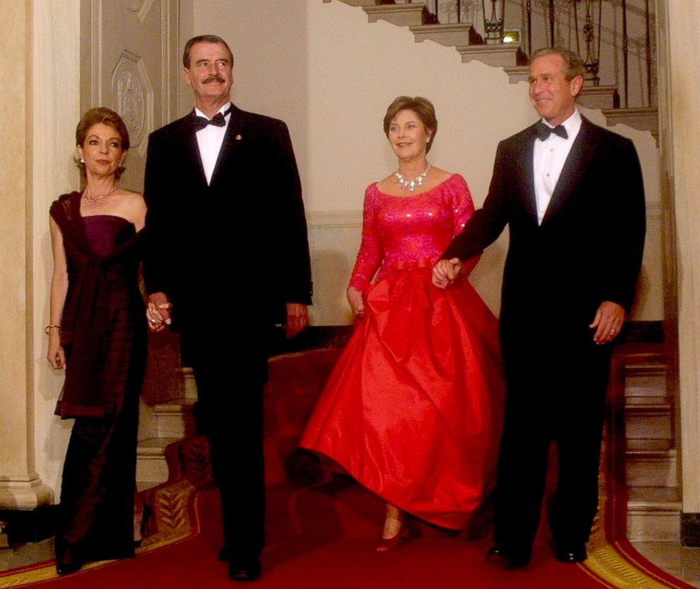 President George W. Bush, first lady Laura Bush, Mexican President Vicente Fox and his wife Martha Fox arrive at a state dinner for the Mexican president Sept. 5, 2001 at the White House in Washington.