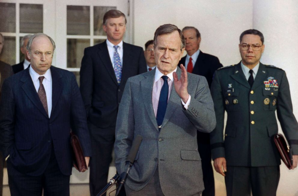PHOTO: President George H.W. Bush talks to reporters in the Rose Garden of the White House after a meeting to discuss the Persian Gulf War. From left, Dick Cheney, Dan Quayle, John Sununu, the president, James A. Baker III, and Gen. Colin Powell.