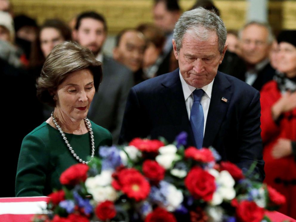 PHOTO: Former President George W. Bush and former First Lady Laura Bush stand at the flag-draped casket of former U.S. President George H.W. Bush as it lies in state inside the U.S. Capitol Rotunda in Washington, Dec. 4, 2018.