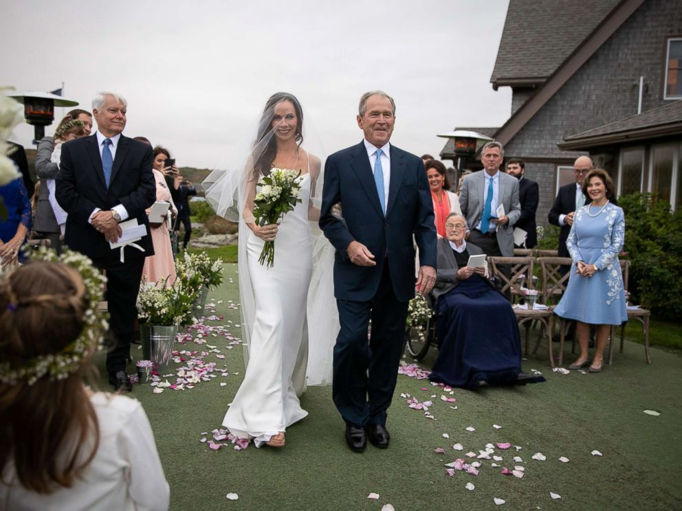 PHOTO: Barbara Pierce Bush walks down the aisle with her father George W. Bush, Oct. 7, 2018.