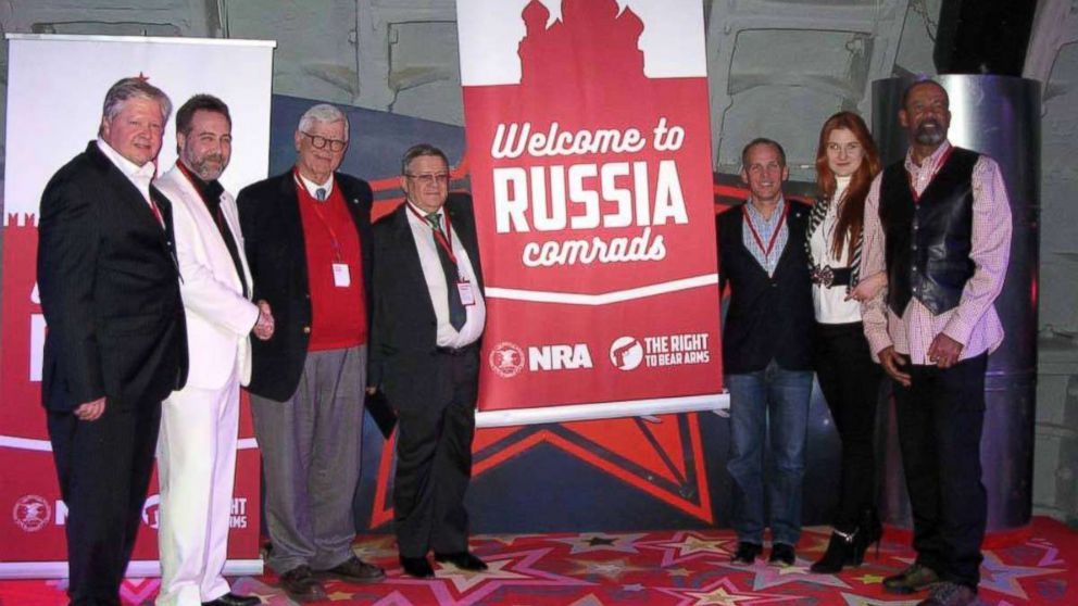 """In a December 2015 Facebook post, a Russian gun-rights enthusiast praised """"the American approach to regulating weapons"""" and shared a photo showing high-ranking NRA members posing alongside Alexander Torshin (fourth from left) and Maria Butina (second from right)."""