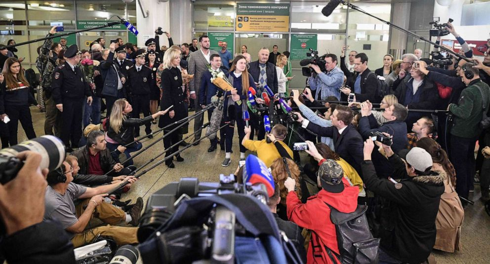 PHOTO: Maria Butina talks to the press as she arrives at Moscows Sheremetyevo airport Oct. 26, 2019.