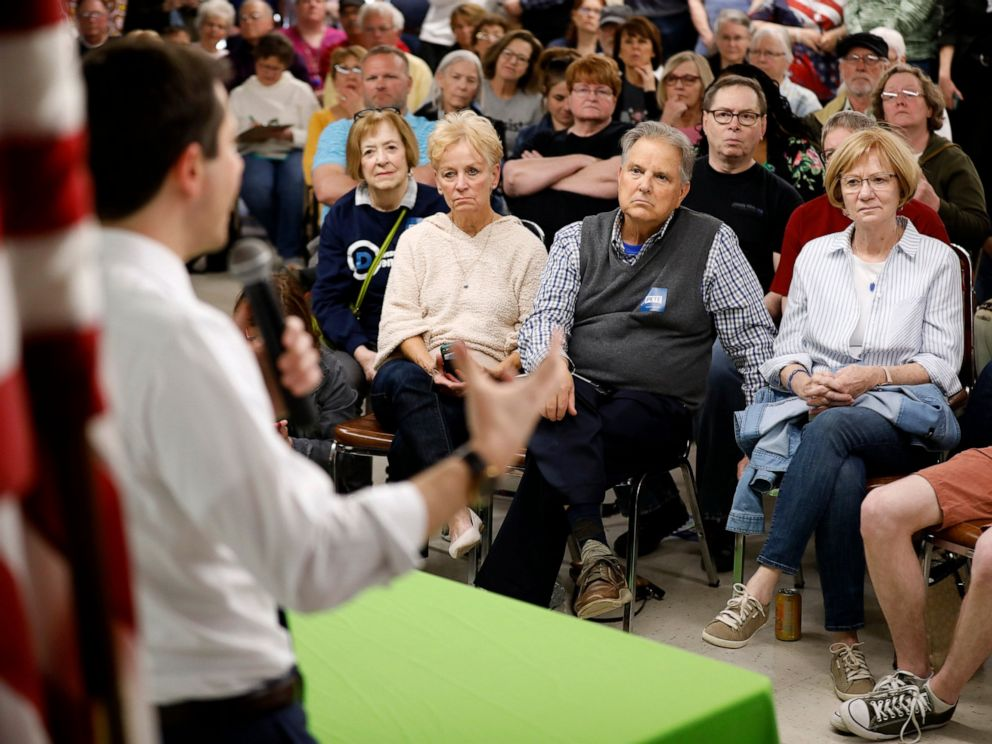 PHOTO: Audience members listen as 2020 Democratic presidential candidate South Bend Mayor Pete Buttigieg speaks during a town hall meeting, Tuesday, April 16, 2019, in Fort Dodge, Iowa.