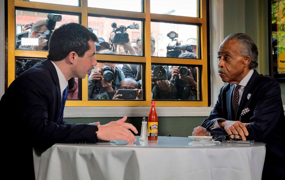 PHOTO: Democratic presidential candidate Mayor Pete Buttigieg of South Bend, Indiana and civil rights leader Rev. Al Sharpton, President of National Action Network, hold a lunch meeting at Sylvias Restaurant in Harlem, New York, April 29, 2019.