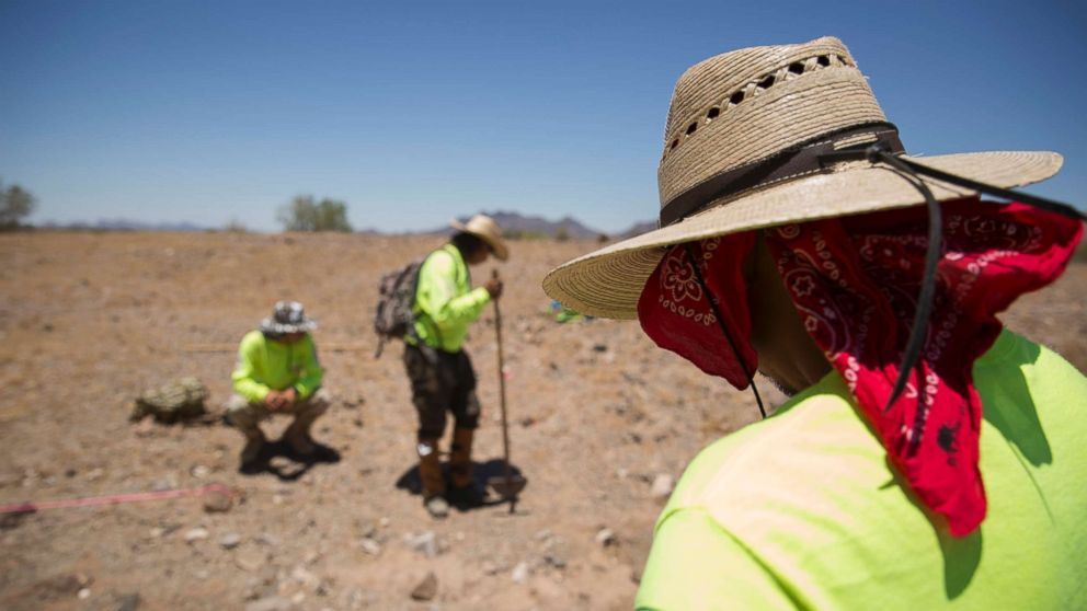 Aguilas del Desierto, Eagkes of the Desert, a search and rescue crew, mark off an area where human remains were found, May 27, 2017, in the Cabeza Prieta wilderness near Ajo, Arizona.