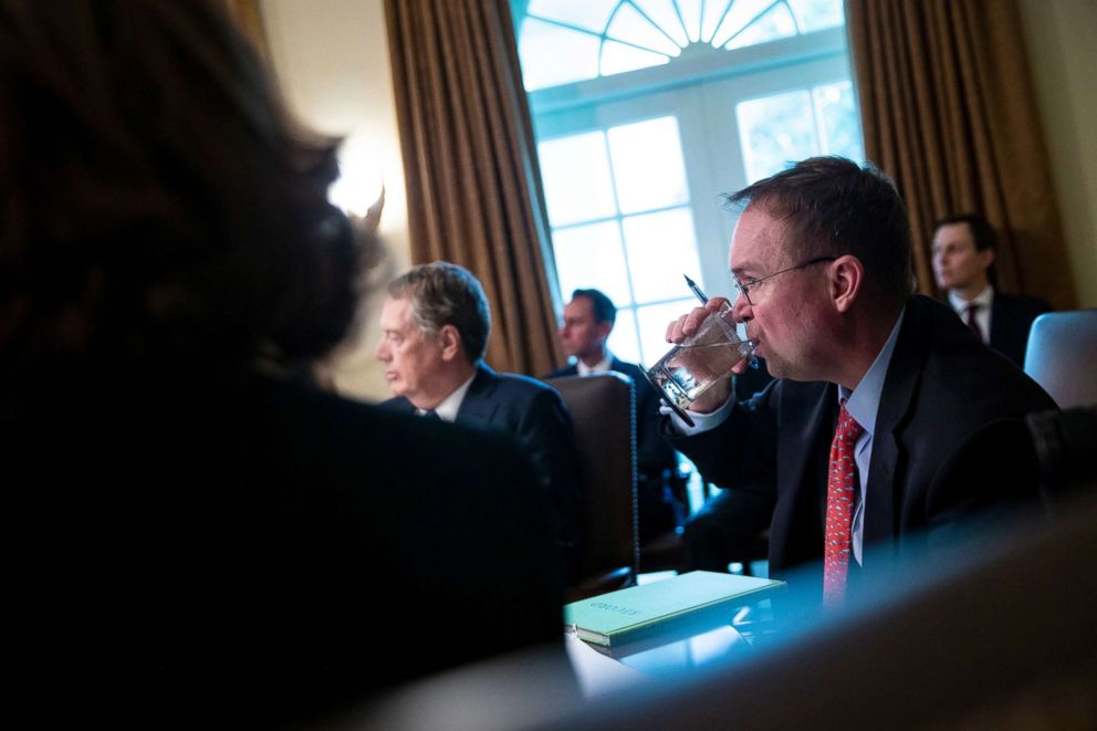 PHOTO: Mick Mulvaney, acting White House chief of staff, takes a drink of water during a cabinet meeting at the White House, Jan. 3, 2019.
