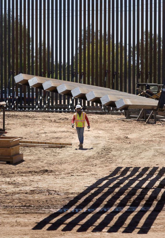 PHOTO: A construction workers walks near fencing at a section of the US-Mexico border wall that is being upgraded on April 18, 2018, in Calexico, Calif.