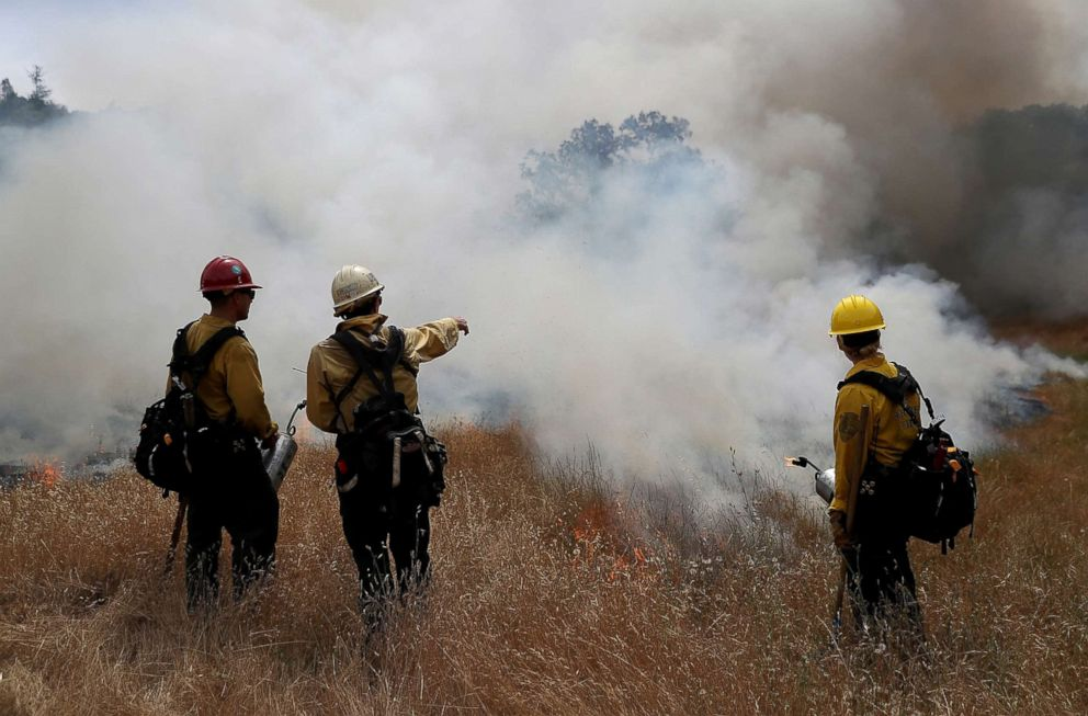 PHOTO: Firefighters monitor a controlled burn at Bouverie Preserve, May 30, 2017 in Glen Ellen, Calif.