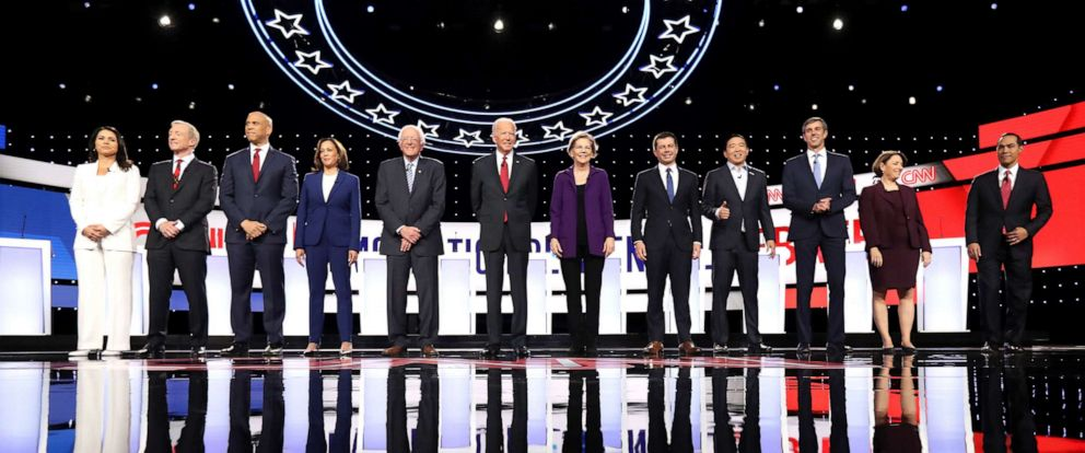 PHOTO: Democratic presidential candidates at the start of the Democratic Presidential Debate at Otterbein University on October 15, 2019 in Westerville, Ohio.