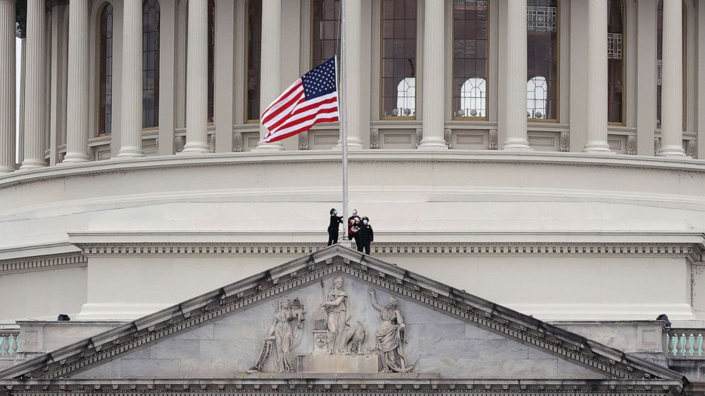 PHOTO: The American flag is lowered to half-staff atop the U.S. Capitol Building following the death of a U.S. Capitol Police Officer, Jan. 8, 2021, in Washington, D.C.