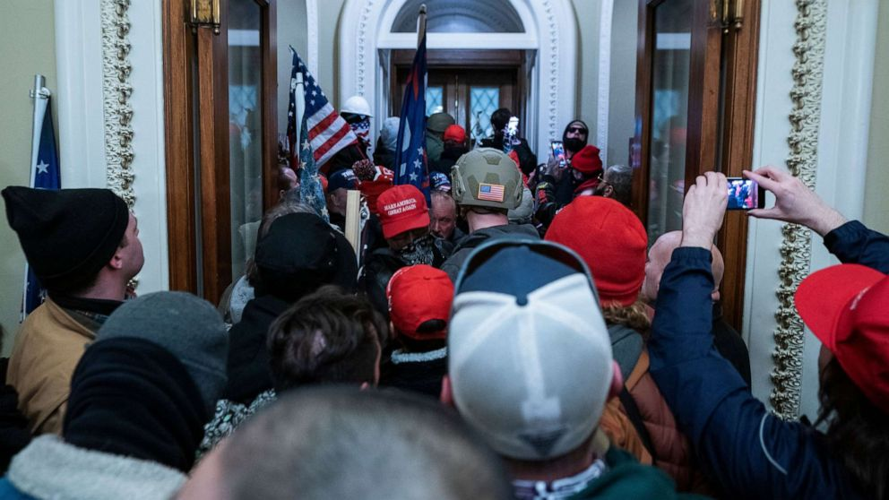 PHOTO: Supporters of President Donald Trump press through the door to the House chamber after breaching Capitol security in Washington, D.C., Jan. 6, 2021.