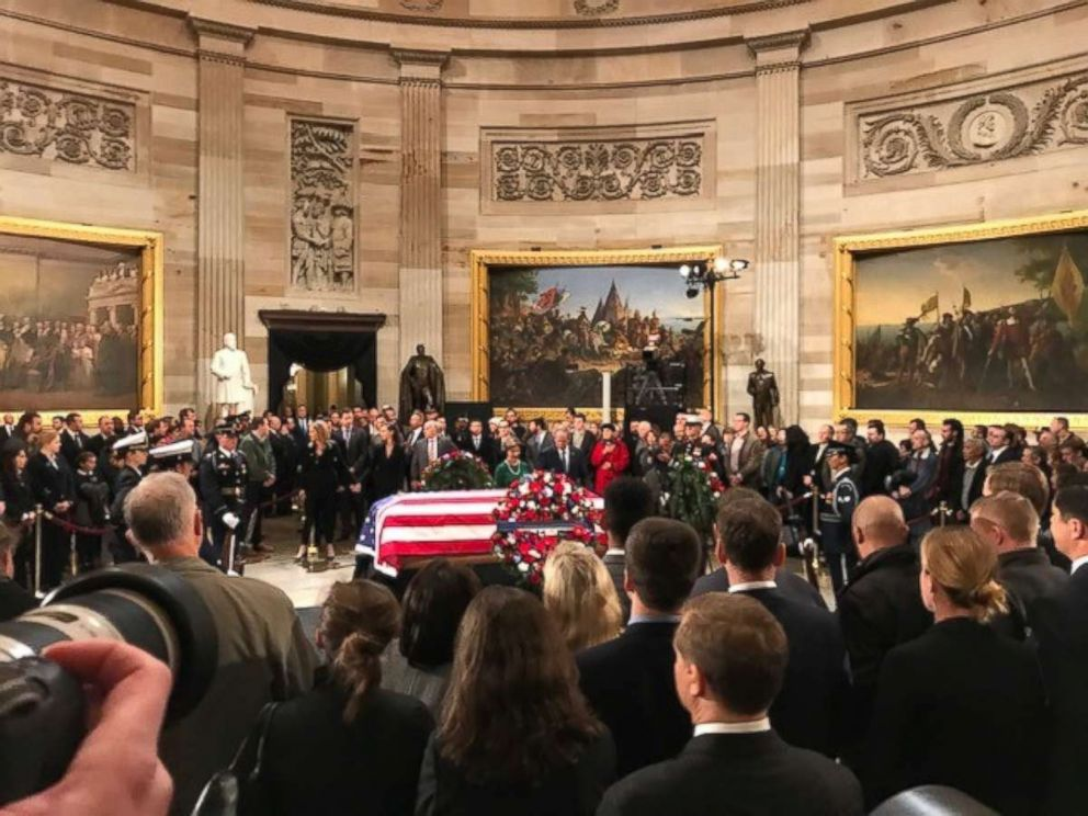 W. Bush and first lady Laura Bush stand in front of his fathers casket as thousands of onlookers gather in the Capitol Rotunda on Tuesday Dec. 4 2018