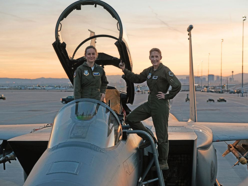 PHOTO: Brie Larson gets hands-on help from Brigadier General Jeannie Leavitt, 57th Wing Commander, on a trip to Nellis Air Force Base in Nevada to research her character, for the film, Captain Marvel.