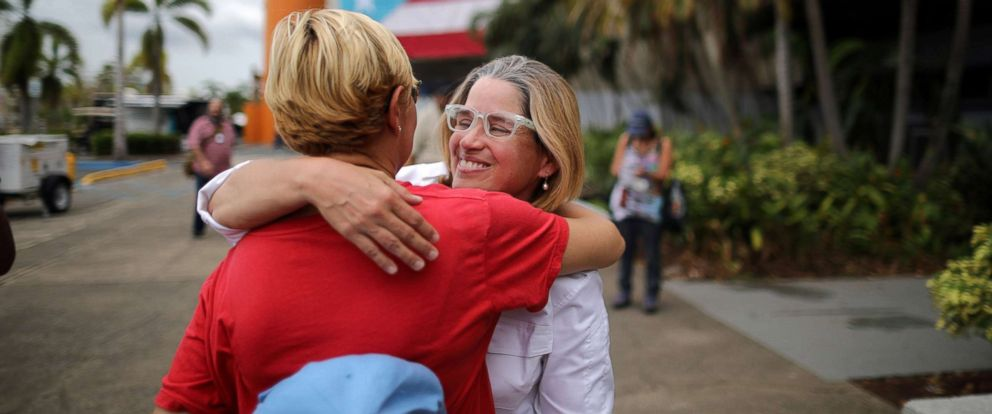 PHOTO: Mayor of San Juan Carmen Yulin Cruz (R) embraces Esperanza Ruiz, a city administrator, outside the government center at the Roberto Clemente Coliseum after Hurricane Maria, in San Juan, Puerto Rico, Sept. 30, 2017.