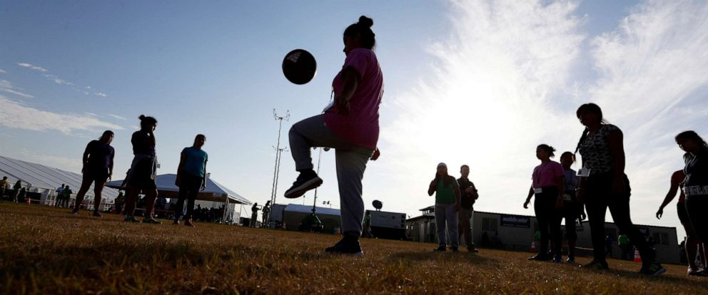 PHOTO: Immigrants play soccer at the U.S. governments newest holding center for migrant children in Carrizo Springs, Texas, July 9, 2019.