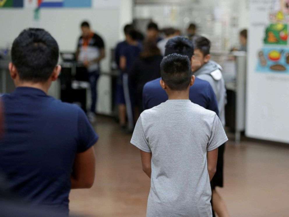 PHOTO: Children stand in line at Casa Padre, an immigrant shelter for unaccompanied minors, in Brownsville, Texas, in a photo released by the Department of Health and Human Services, June 14, 2018.