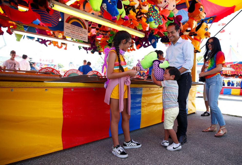PHOTO: Democratic 2020 U.S. presidential candidate and former HUD Secretary Julian Castro with his wife Erica, their daughter Carina and their son Cristian tour the Iowa State Fair in Des Moines, Iowa, U.S., August 9, 2019.
