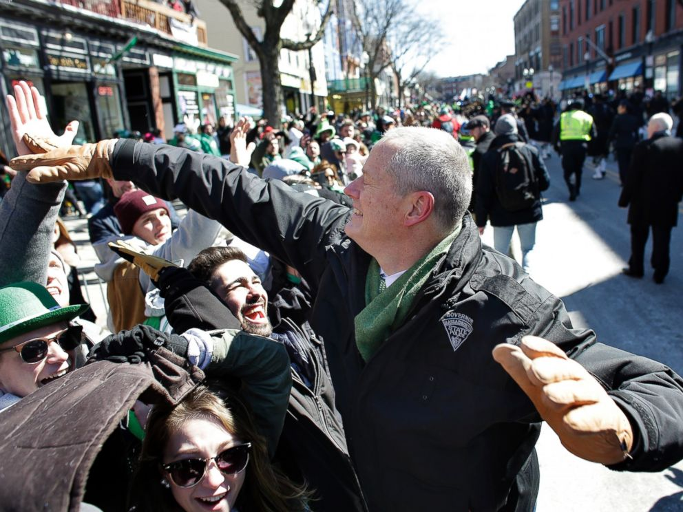 Massachusetts Gov. Charlie Baker, right, greets people in the crowd during the annual St. Patricks Day parade, Sunday, March 18, 2018, in Boston.