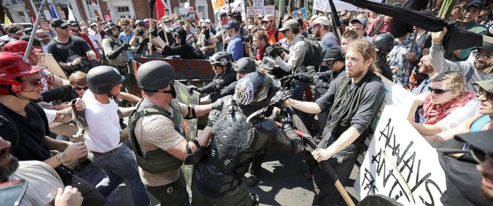 """PHOTO: White nationalists, neo-Nazis and members of the """"alt-right"""" clash with counter-protesters as they enter Lee Park during the """"Unite the Right"""" rally, Aug. 12, 2017, in Charlottesville, Va."""