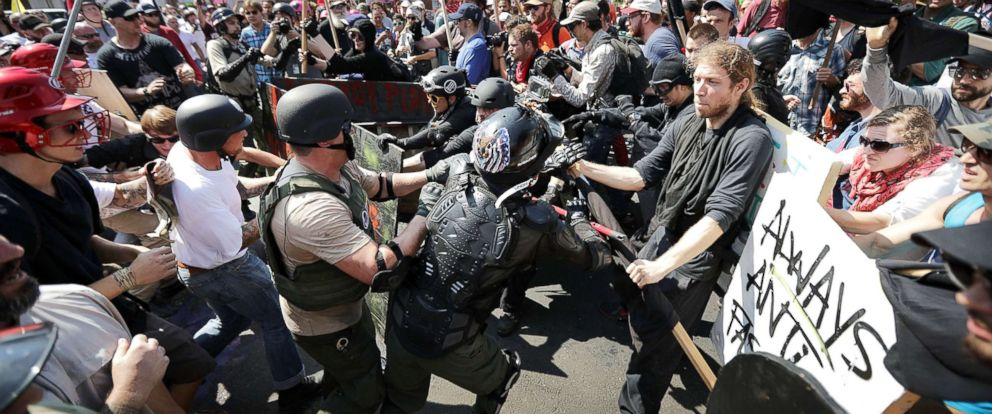 """PHOTO: White nationalists, neo-Nazis and members of the """"so-called alt-right"""" clash with counter-protesters as they enter Lee Park during a rally on Aug. 12, 2017 in Charlottesville, Va."""
