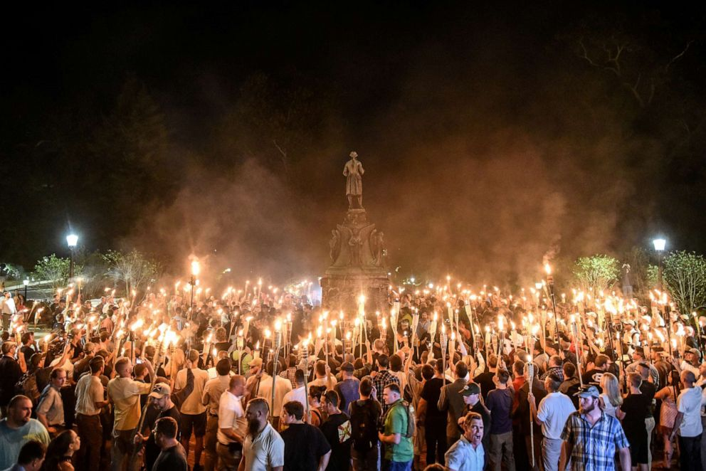 PHOTO: White nationalists participate in a torch-lit march on the grounds of the University of Virginia ahead of the Unite the Right Rally in Charlottesville, Va., Aug. 11, 2017.