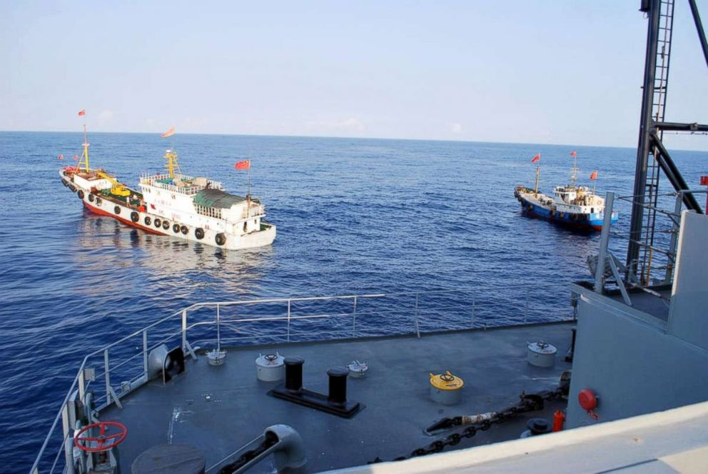 PHOTO: Two Chinese trawlers stop directly in front of the military Sealift Command ocean surveillance ship forcing the ship to conduct an emergency all stop in order to avoid collision.