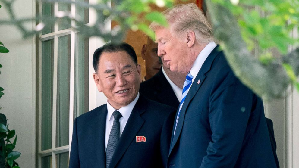 President Donald Trump talks with Kim Yong Chol, former North Korean military intelligence chief as they walk from their meeting in the Oval Office of the White House, June 1, 2018.
