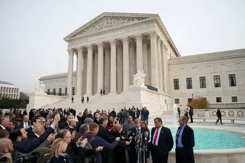 PHOTO: New Jersey Governor Chris Christie and attorney Ted Olson speak to members of the media in front of the U.S. Supreme Court, Dec. 4, 2017 in Washington.