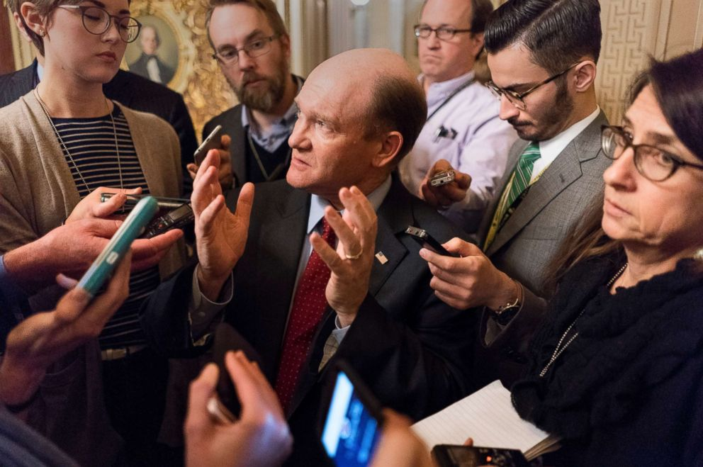 PHOTO: Sen. Chris Coons talks to reporters after a meeting with fellow Democrats on Capitol Hill in Washington, D.C., Jan. 19, 2018.