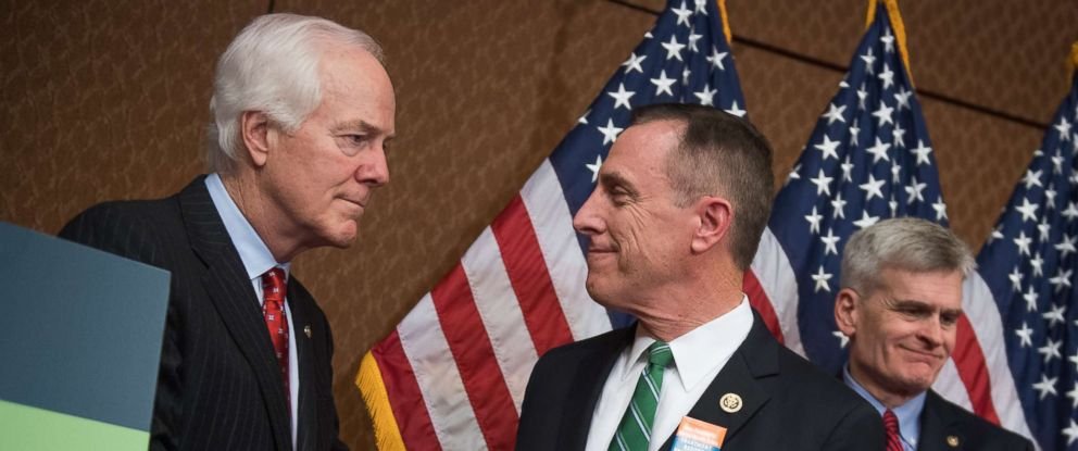 PHOTO: Senate Majority Whip John Cornyn shakes hands with Rep. Tim Murphy during a press conference at the Capitol Visitor Center, Dec. 5, 2016 in Washington.