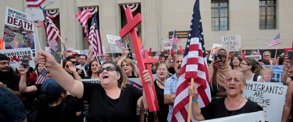 PHOTO: Protesters rally outside the federal court just before a hearing to consider a class-action lawsuit filed on behalf of Iraqi nationals facing deportation, in Detroit, June 21, 2017.