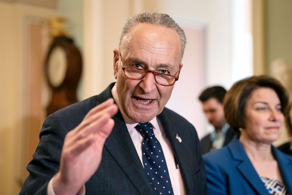 Senate Minority Leader Chuck Schumer joined at right by Sen. Amy Klobuchar speaks to reporters at the Capitol in Washington, Tuesday, April 9, 2019.