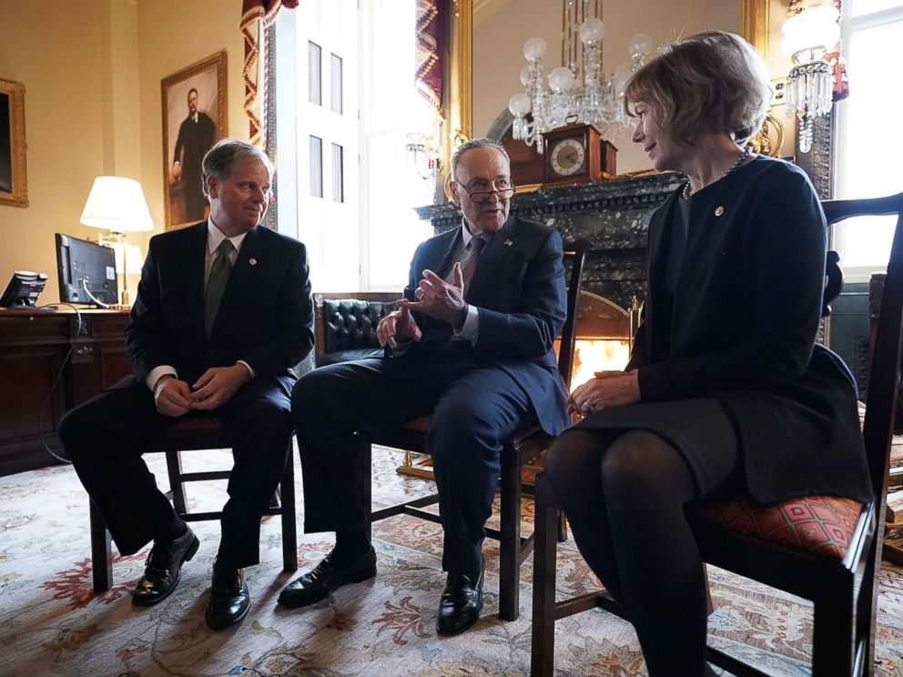 PHOTO: Senate Minority Leader Chuck Schumer, center, speaks to Sen. Doug Jones and Sen. Tina Smith during a meeting at the U.S. Capitol, Jan. 3, 2018, in Washington.