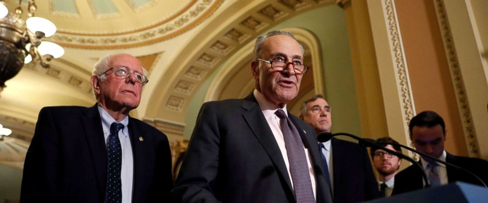 PHOTO: Senate Minority Leader Chuck Schumer, accompanied by Sen. Bernie Sanders and Sen. Jeff Merkley, speaks with reporters following the party luncheons on Capitol Hill in Washington, Oct. 3, 2017.