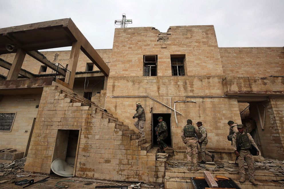 PHOTO: Iraqi soldiers inspect the debris on January 22, 2017 at St. Georges Monastery (Mar Gurguis), a historical Chaldean Catholic church on the northern outskirt of Mosul, which was destroyed by Islamic State (IS) group in 2015.