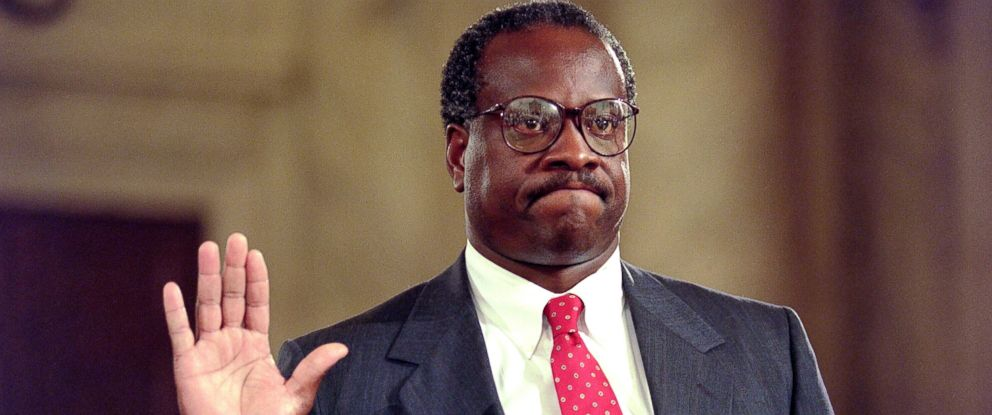 PHOTO: Supreme Court nominee Clarence Thomas raises his right hand as he is sworn in, Sept. 10, 1991, during confirmation hearings before the Senate Judiciary Committee in Washington.