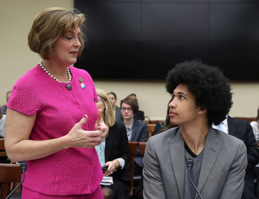 PHOTO: Rep. Kathy Castor talks with Aji Piper, a plaintiff in the Juliana v. United States climate lawsuit, at the first hearing of the House Select Committee on the Climate Crisis, on Capitol Hill, April 4, 2019, in Washington.