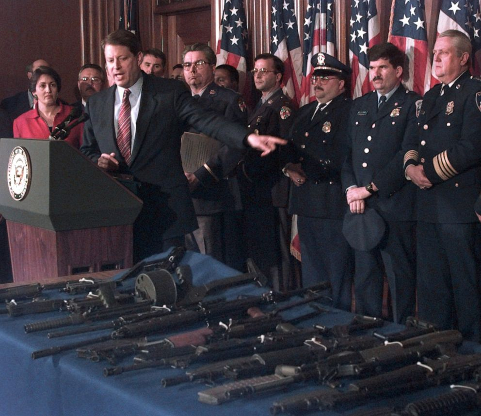 PHOTO: Vice President Al Gore, flanked by Deputy Attorney General Jaime Gorelick, far left, and Maryland Police Superintendent David Mitchell, gestures toward various assault weapons during a news conference in Washington D.C., March 22, 1996.