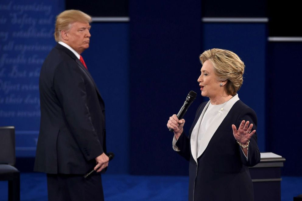 PHOTO: Democratic presidential candidate Hillary Clinton speaks, as Republican presidential candidate Donald Trump listens, during the second presidential debate at Washington University in St. Louis, Oct. 9, 2016.