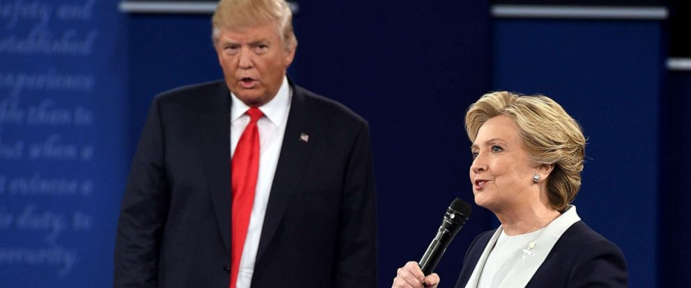 PHOTO: Democratic presidential candidate Hillary Clinton and Republican presidential candidate Donald Trump debate during the second presidential debate at Washington University in St. Louis, Missouri, Oct. 9, 2016.