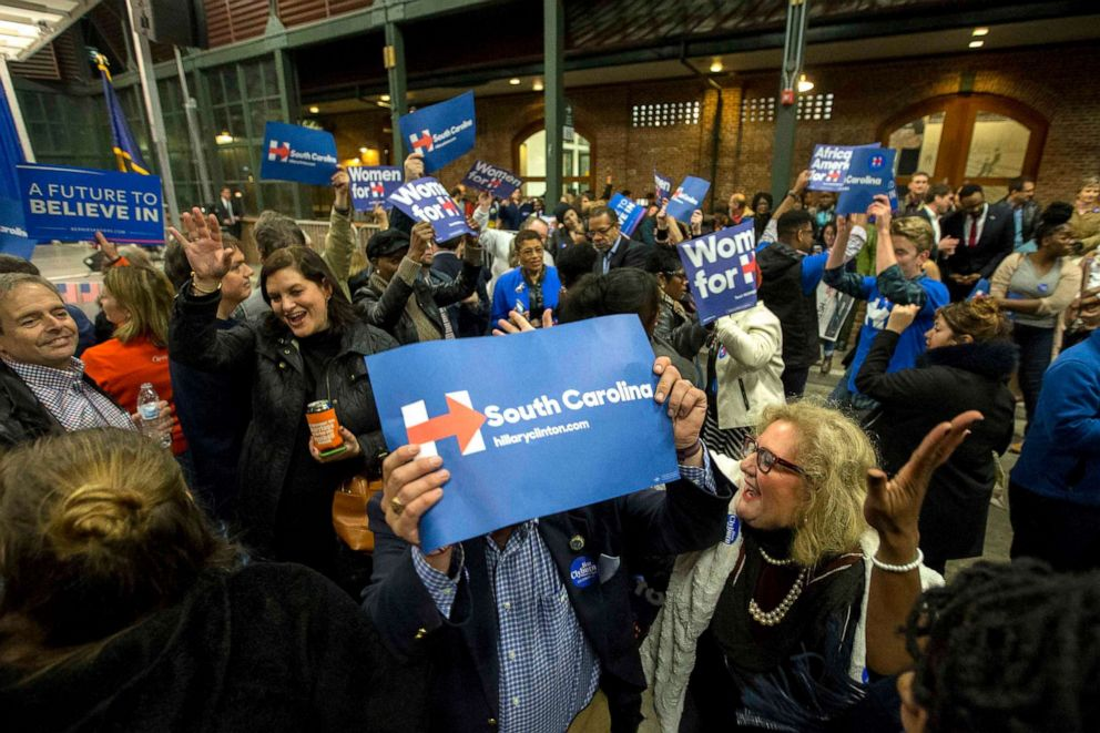 PHOTO: Supporters wave signs, as they dance and sing while they wait for Democratic presidential candidate Hillary Rodham Clinton to arrive at the Jim Clyburn Fish Fry, Jan. 16, 2016, at the Charleston Visitor Center in Charleston, S.C.