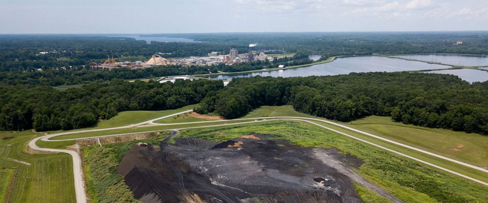 PHOTO: This is an aerial view of a coal ash site near the KapStone Paper and Packing Corp. plant (top) along the Roanoke River in Roanoke Rapids, N.C., June 21, 2018.
