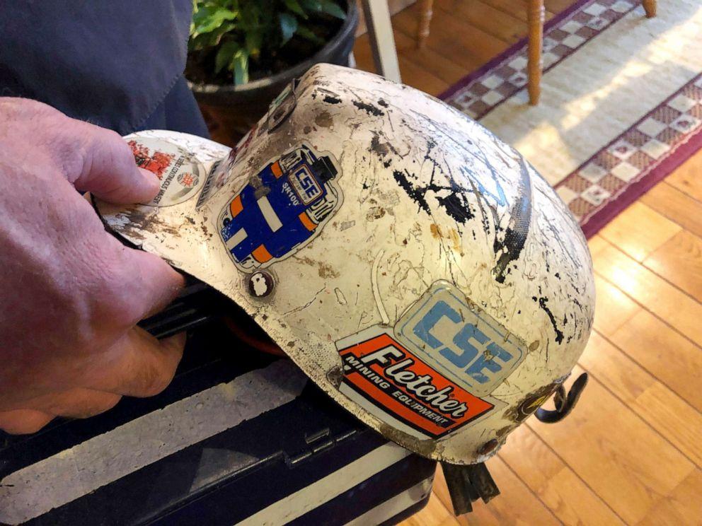 PHOTO: A retired coal miner displays his mining helmet at his home in Coeburn, Va., Jan. 24, 2019.