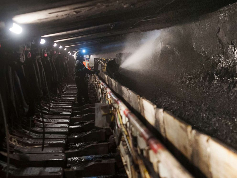 PHOTO:A coal miner works in a longwall mining tunnel at the Consol Energy Bailey Mine in Wind Ridge, Pa., May 14, 2013.