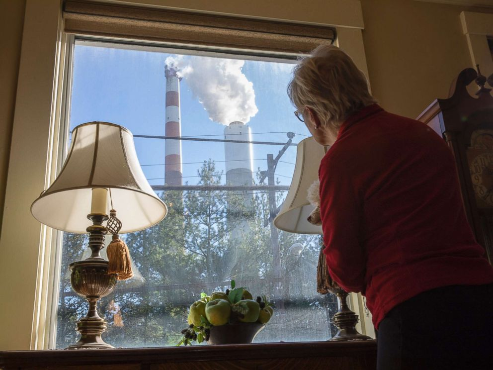 PHOTO: Marti Blake looks out her front window at the smoke stack of the 47-year old Cheswick coal-fired power plant, Oct. 27, 2017 in Springdale, Pa.