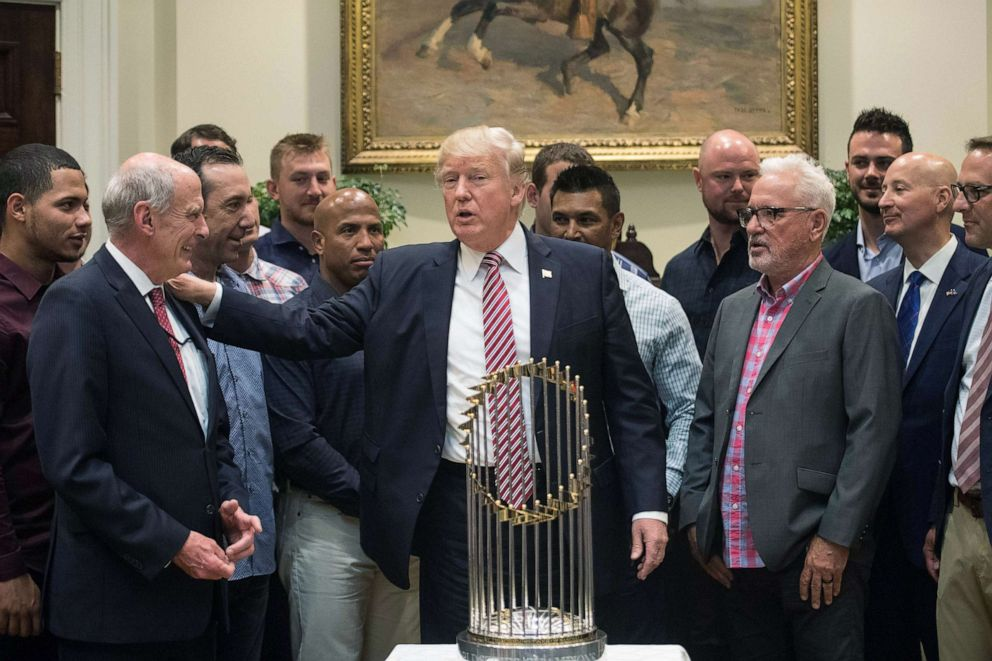 PHOTO:President Donald Trump speaks with Director of National Intelligence Dan Coats as he meets with members of the Chicago Cubs baseball team in the Roosevelt Room at the White House, June 28, 2017.