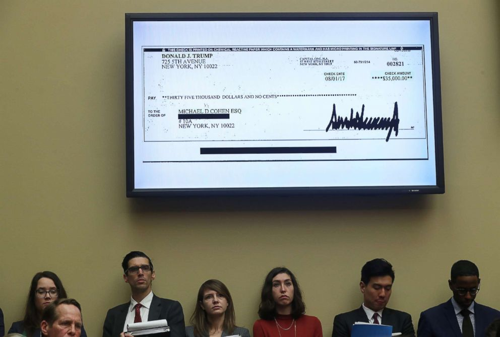 PHOTO: A $35,000 check signed by President Donald Trump to Michael Cohen, his former personal attorney, is shown on a television monitor inside the hearing room as Cohen testifies in Washington, D.C., Feb. 27, 2019.